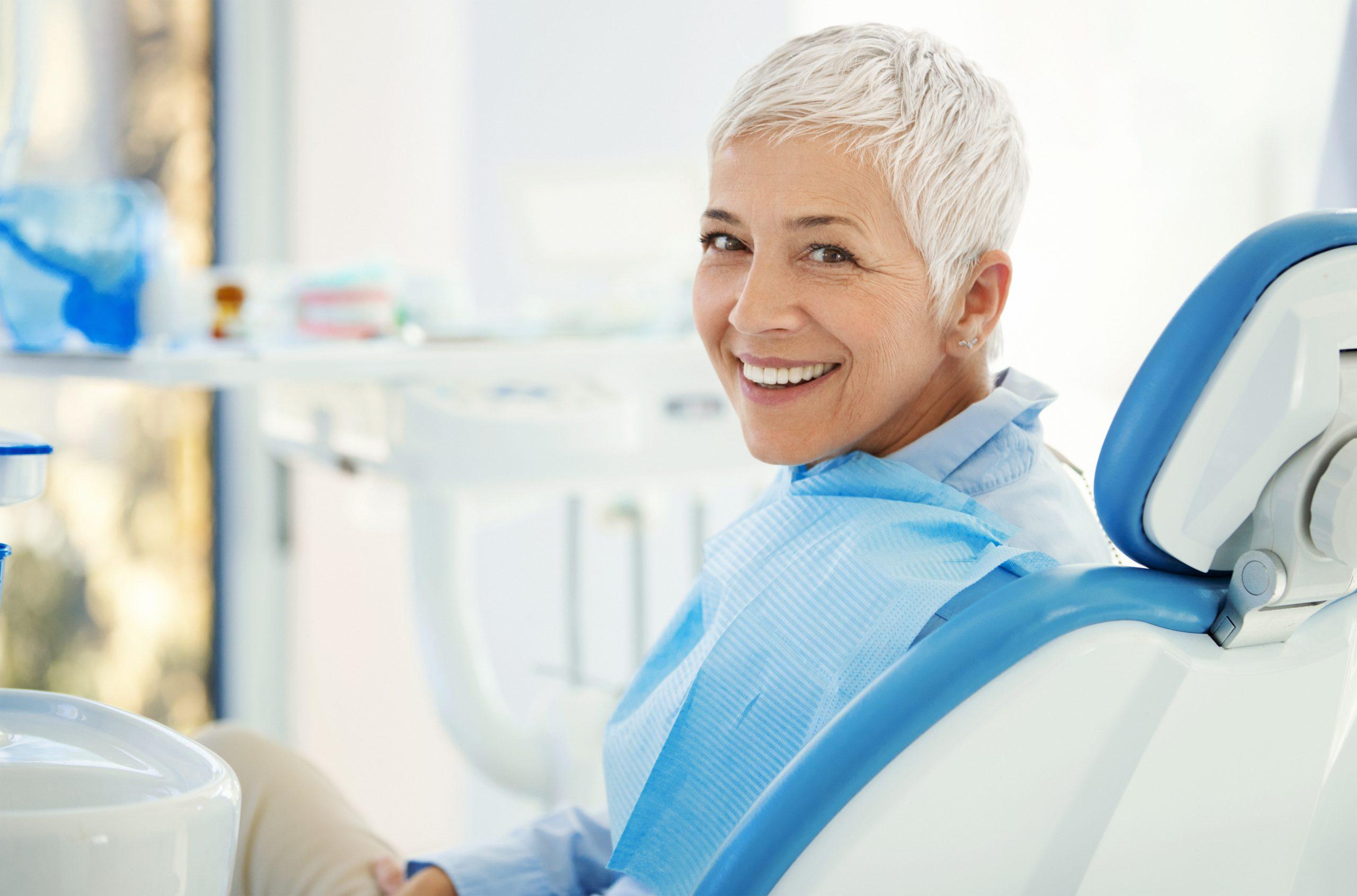 woman in dental chair getting dental restoration treatment.