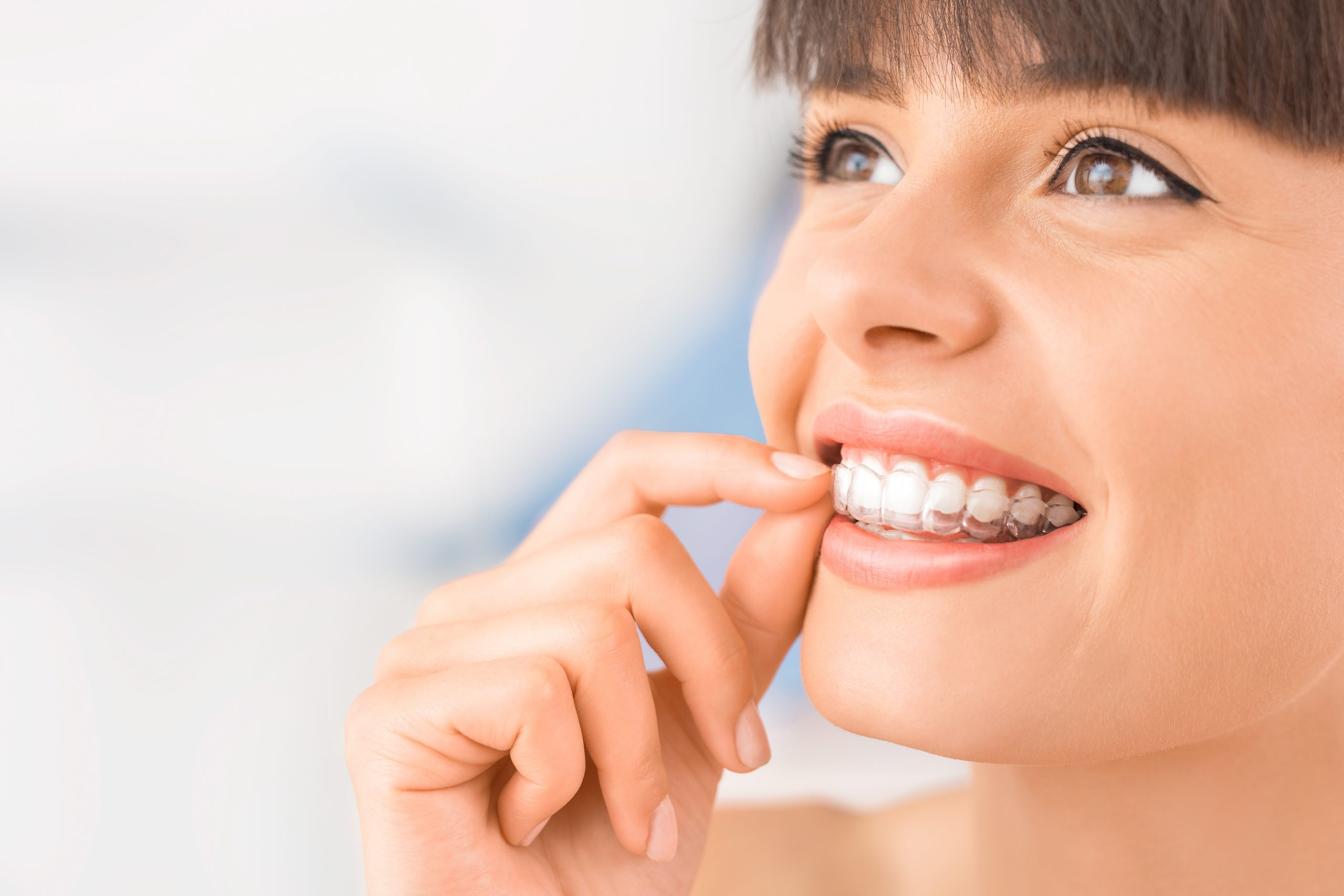 Woman wearing Invisalign retainer