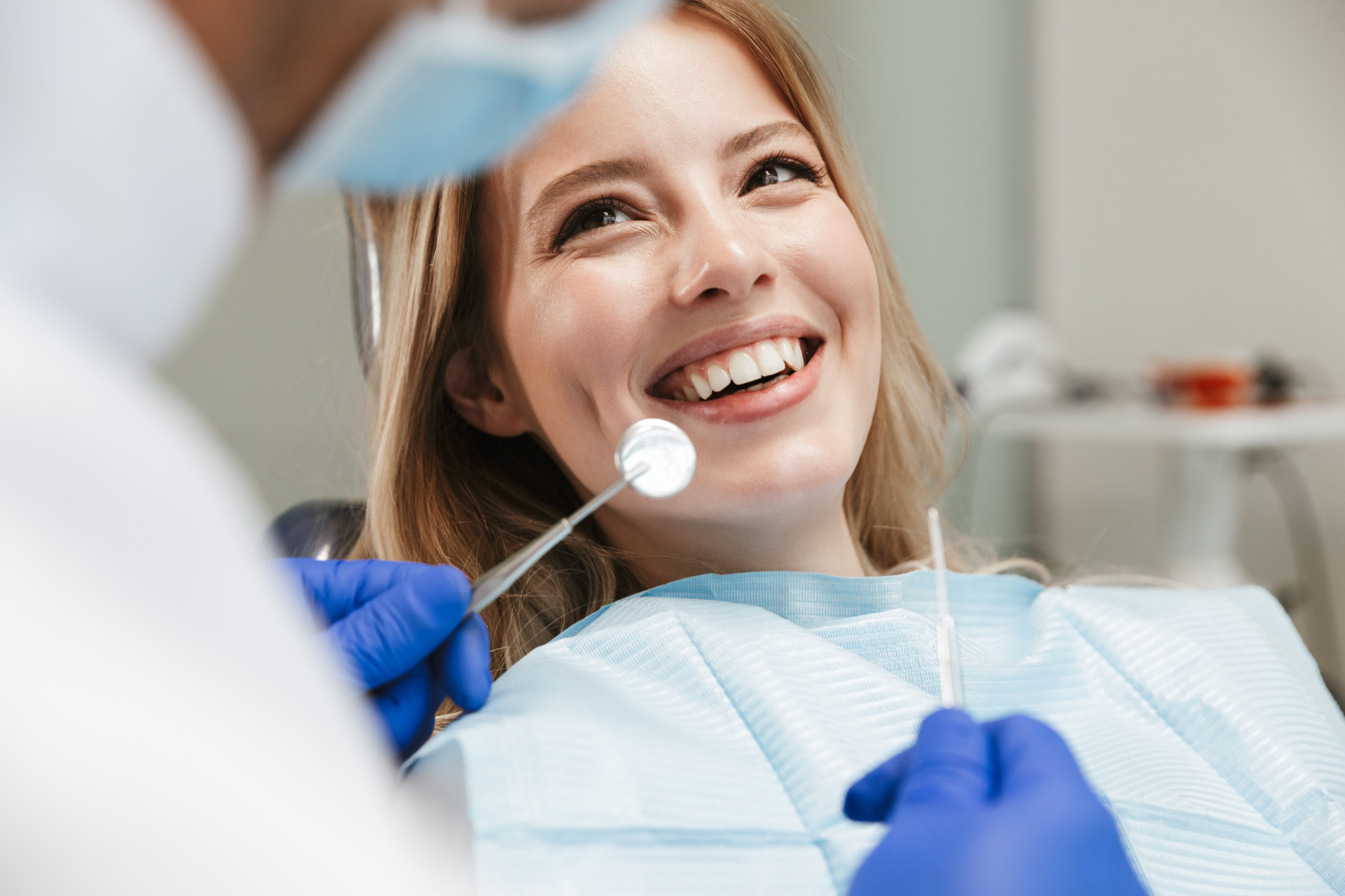 woman receiving dental fillings while sitting in dental chair